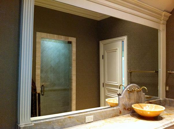 Custom framed bathroom mirro