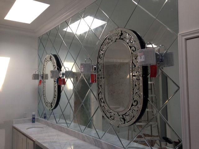 Custom framed mirrors on mirror wall